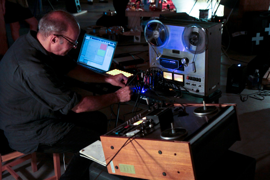 Jed Speare at a laptop and TWO reel to reel tape decks - Photo by Kristophe Diaz